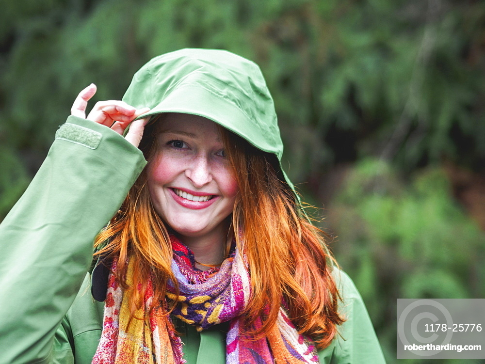 Portrait of smiling redhead in green jacket