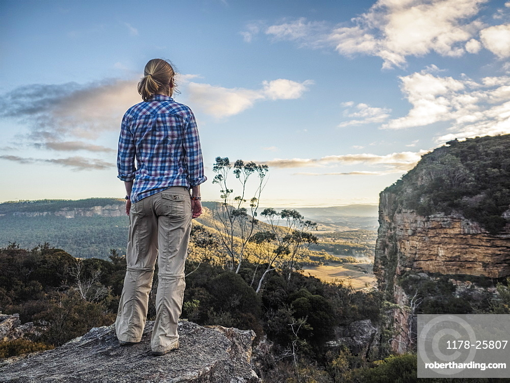 Australia, New South Wales, Blue Mountains, Blackheath, Megalong Valley, Mature woman standing on rock and looking at valley below