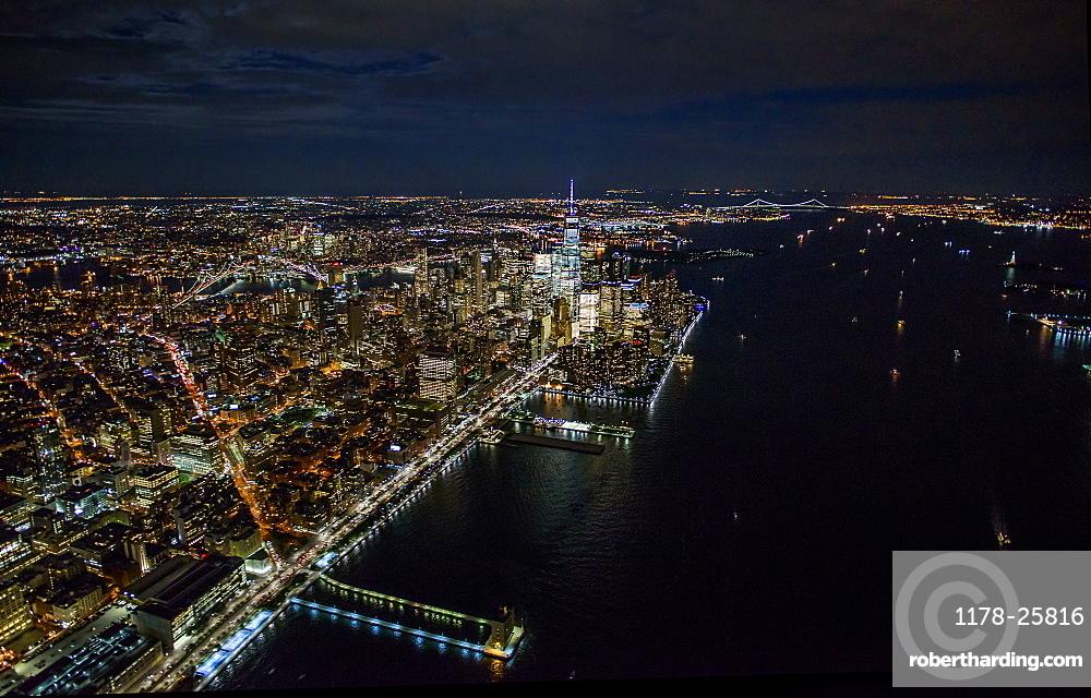 USA, New York, New York City, Aerial view of illuminated skyline at night