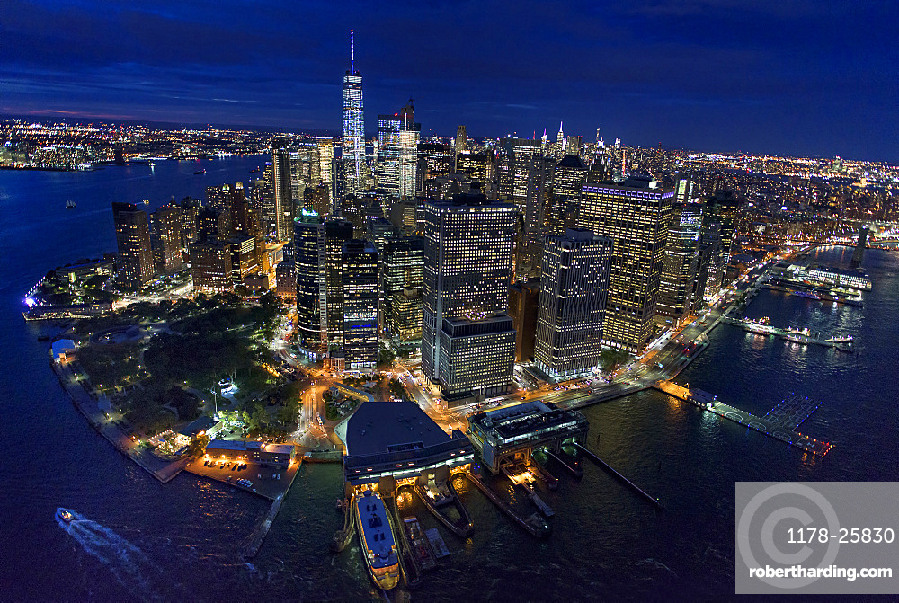 USA, New York, New York City, Manhattan, Aerial view of illuminated skyline with harbor at night