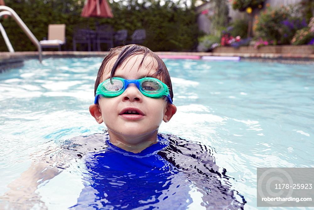 Boy (4-5) playing in pool