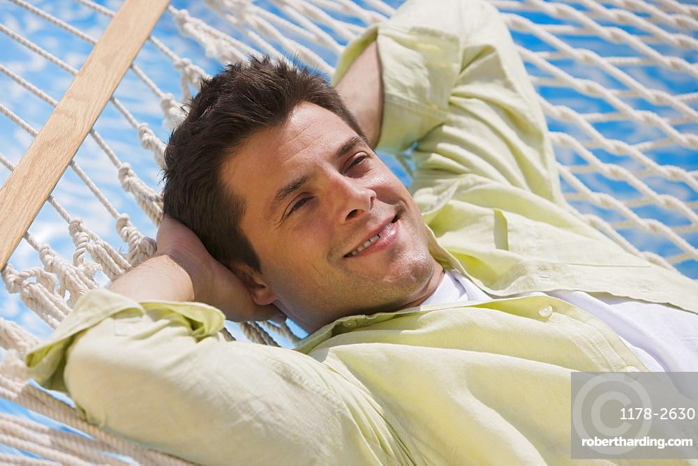 Man laying in hammock