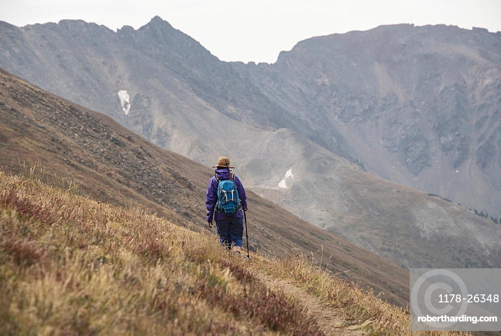 Woman hiking on Loveland Pass, Colorado, West Ridge Trail, Loveland Pass, Colorado, USA