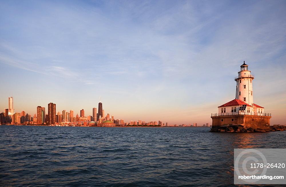 Chicago Harbor Lighthouse at sunrise in Chicago, Illinois, USA