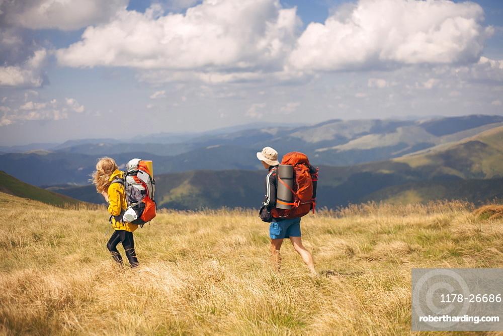 Couple hiking in the Carpathian Mountain Range