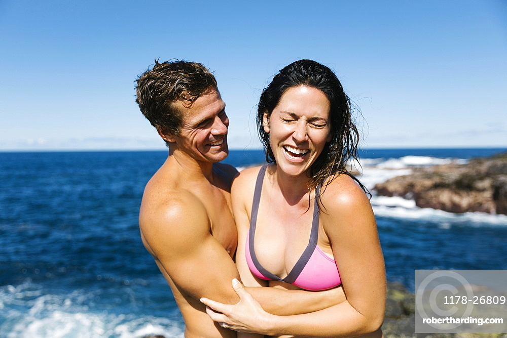 Couple laughing by sea