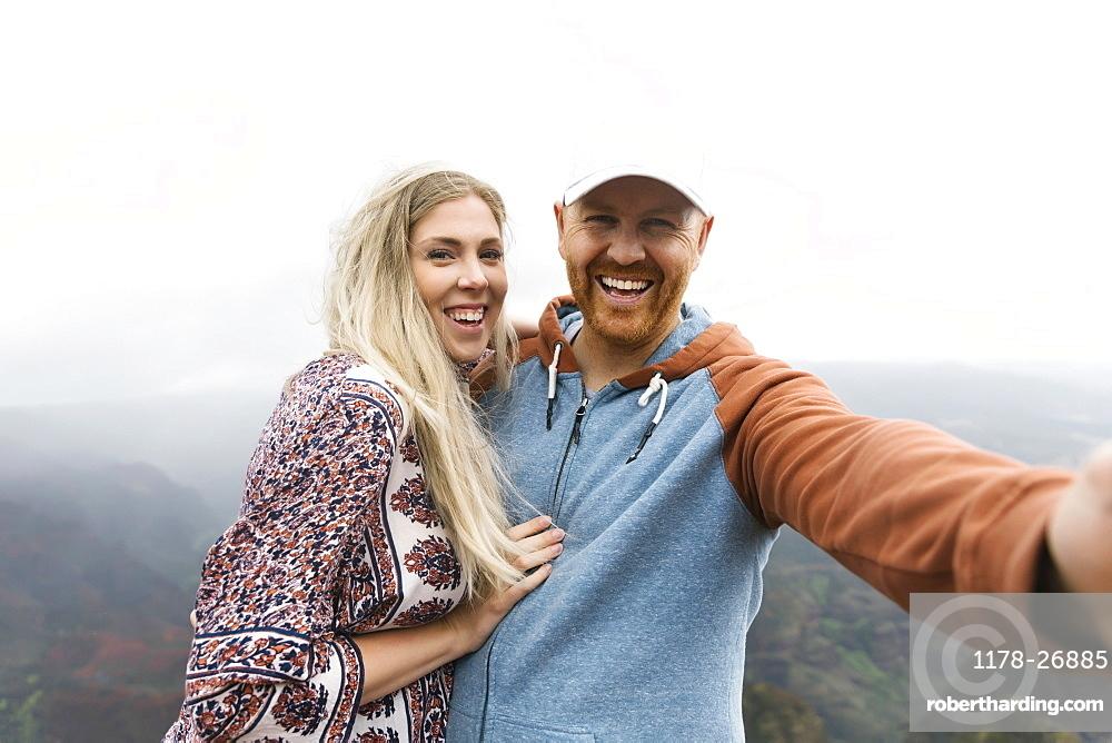 Mid adult couple taking selfie
