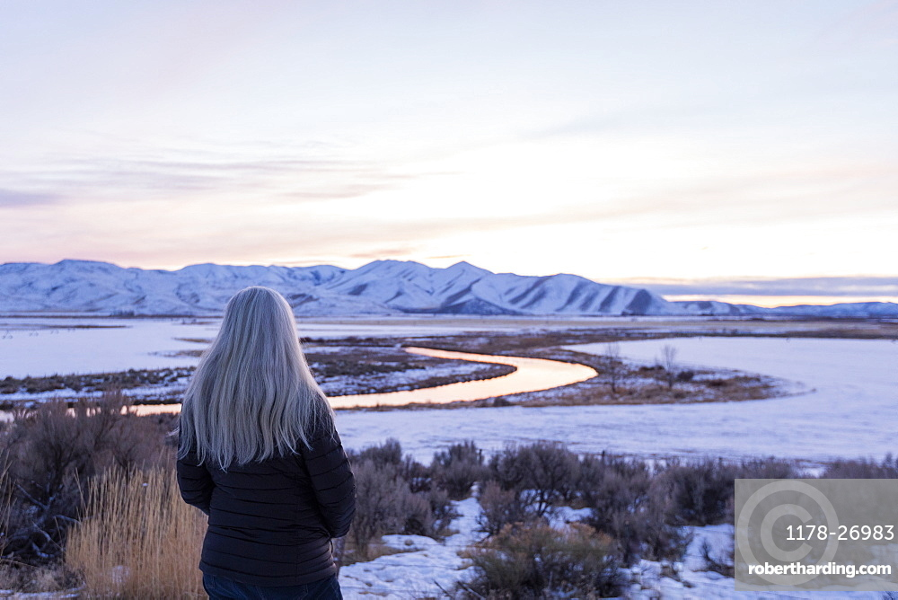 Mature woman by river during winter in Picabo, Idaho