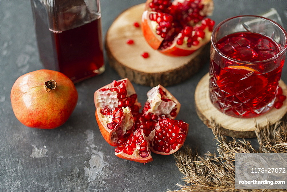 Pomegranates with glass of juice