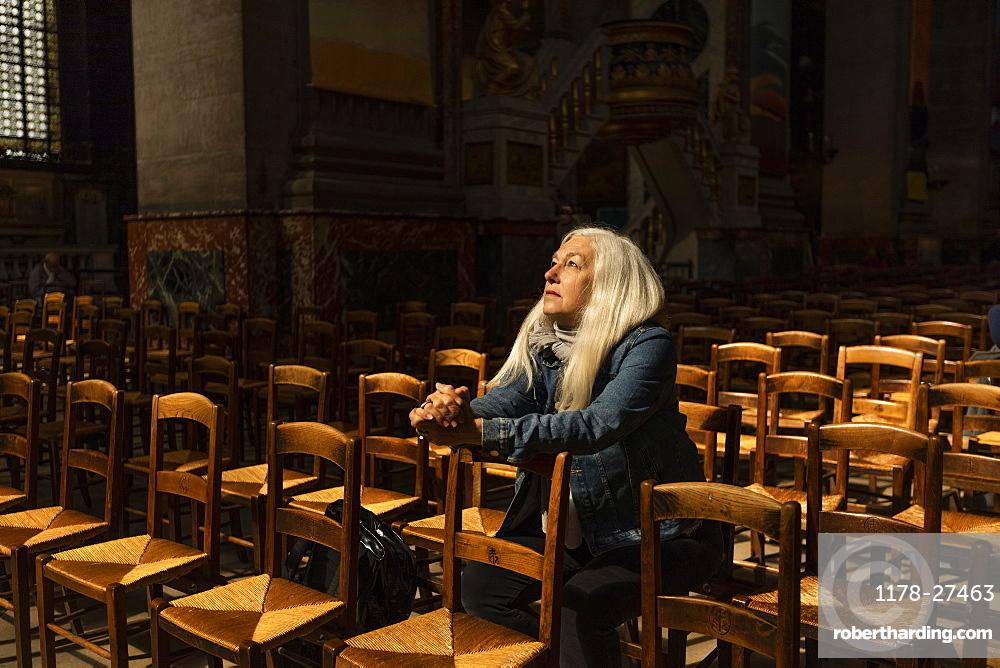 Mature woman sitting in church