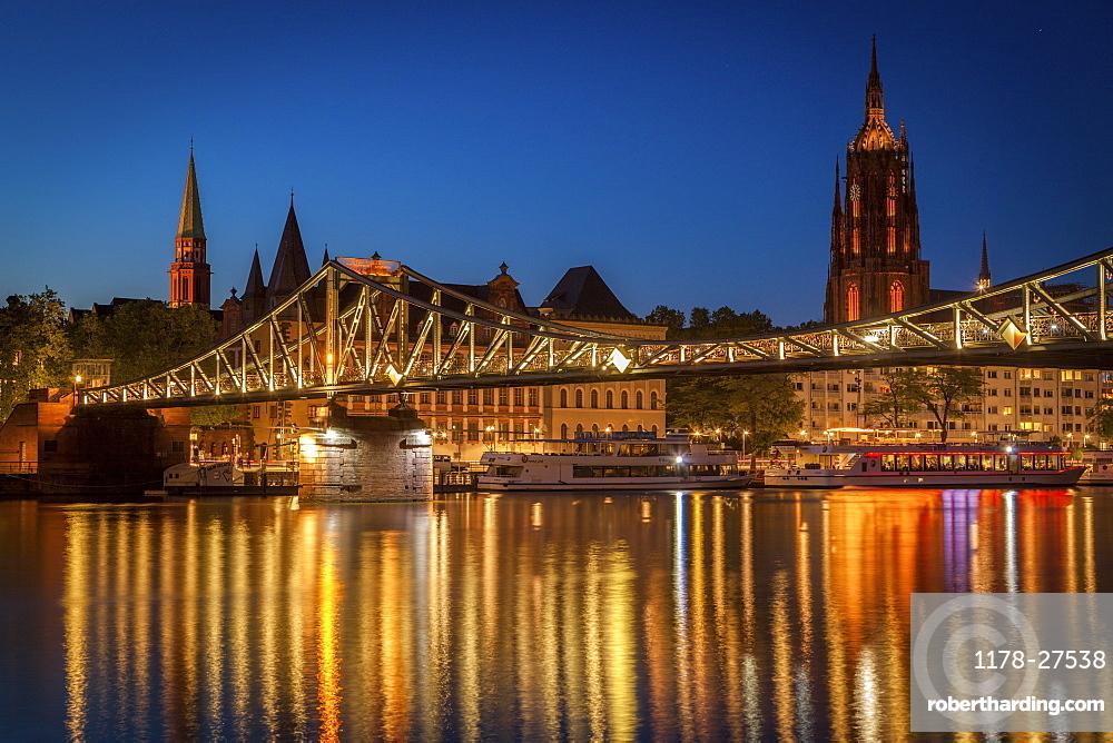 Bridge over river at sunset in Frankfurt, Germany