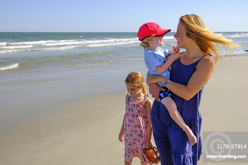 Mother and children walking on beach
