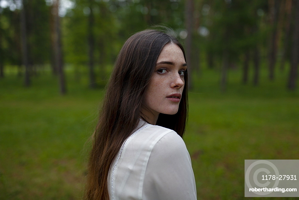 Young woman by forest