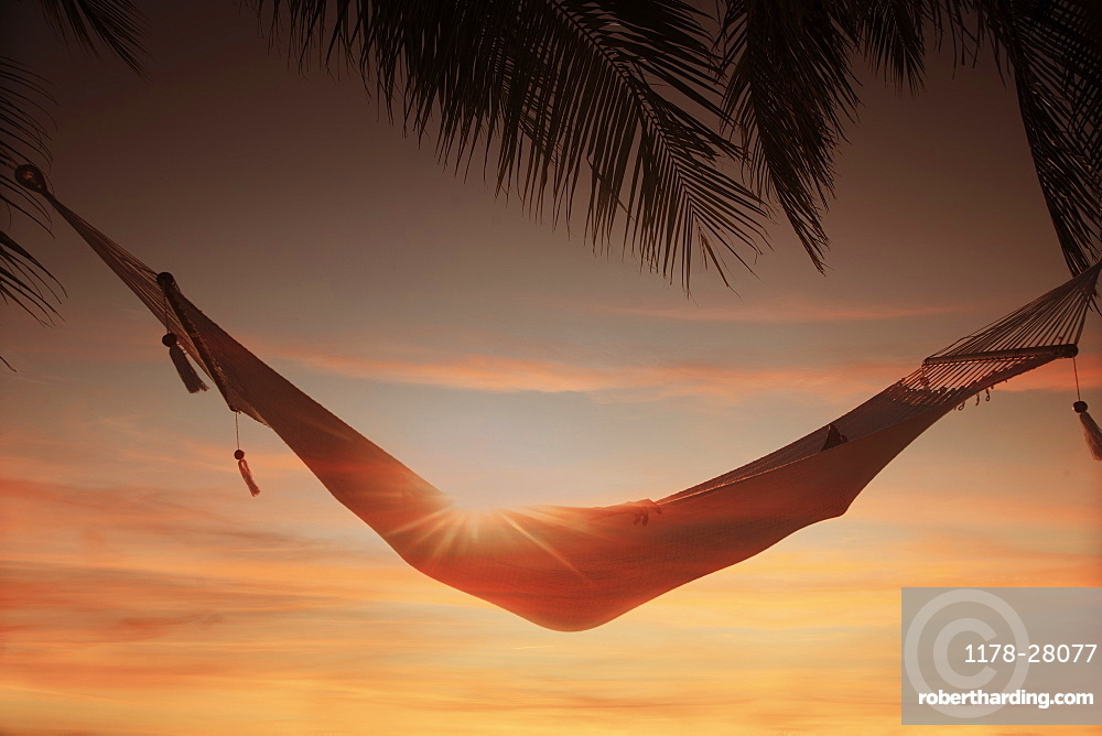 Woman inside hammock at sunset at Miami Beach in Miami, Florida, United States of America