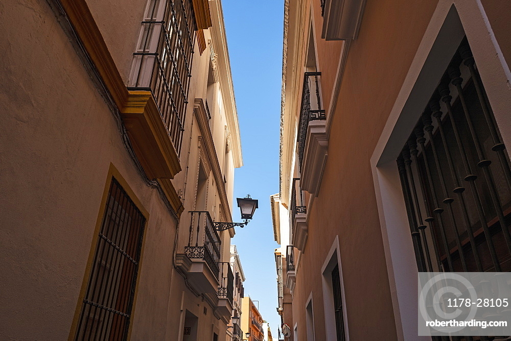 Low angle shot of townhouses in Seville, Andalusia, Spain