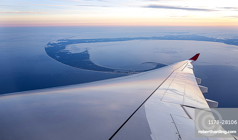 Airplane wing against aerial view of Lower Cape Cod, Massachusetts, United States of America