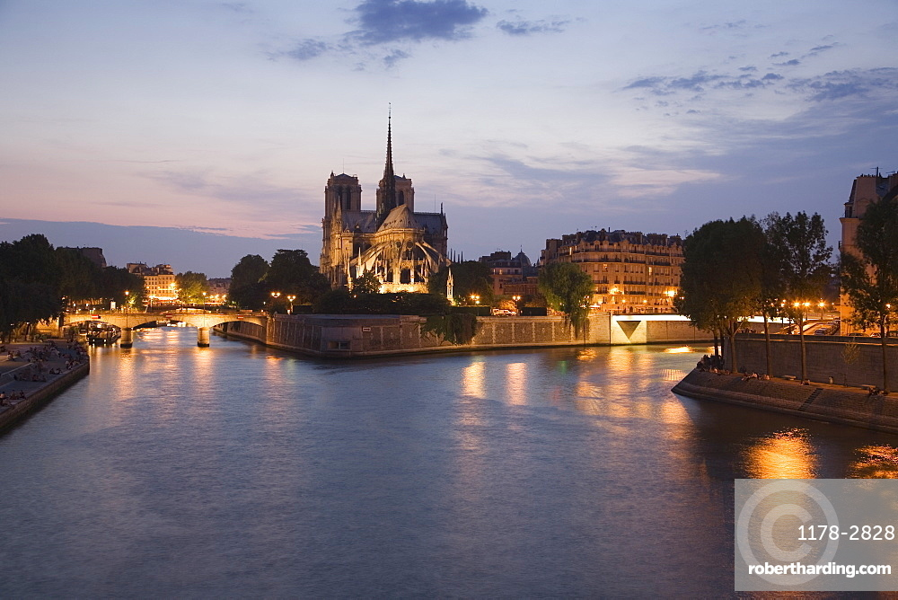 Scenic view of cathedral next to water at night