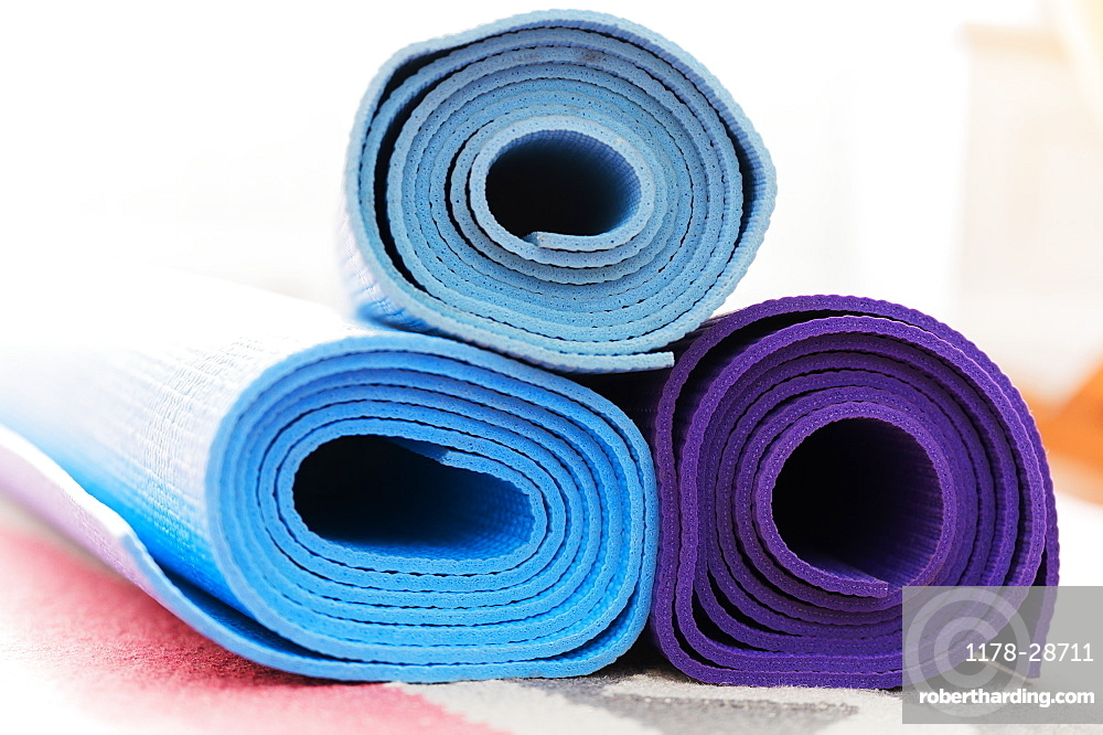 Pile of yoga mats on floor