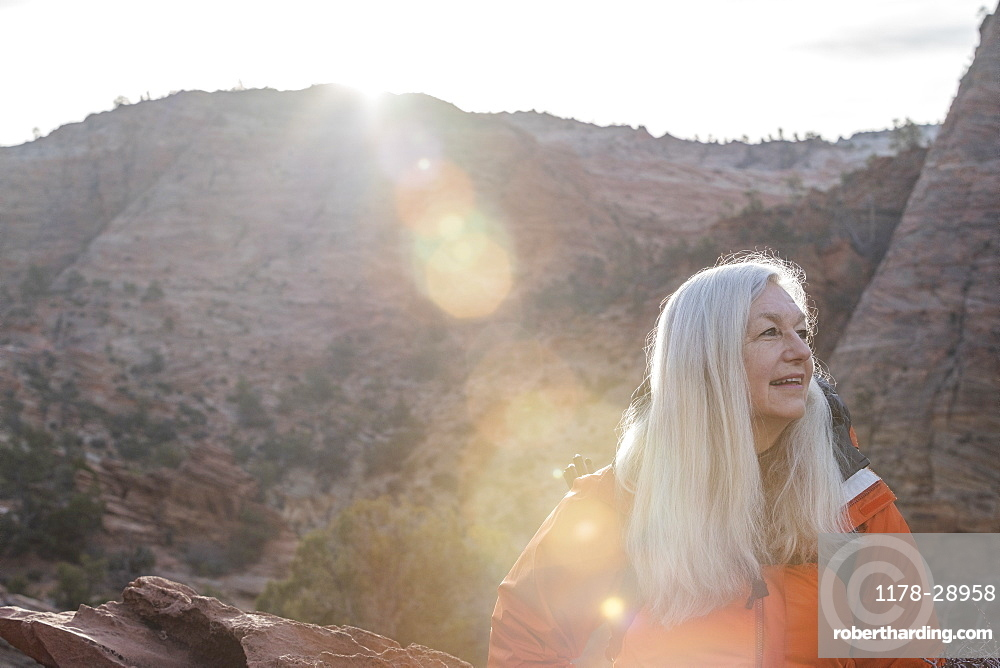 Smiling woman by canyon at Zion National Park in Utah, USA