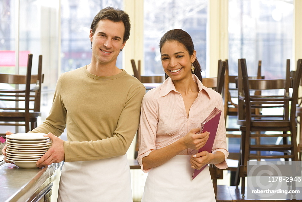 Male and female servers in restaurant