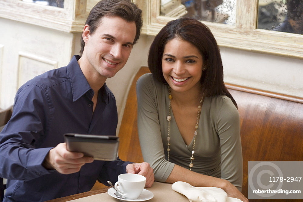 Couple paying bill at restaurant