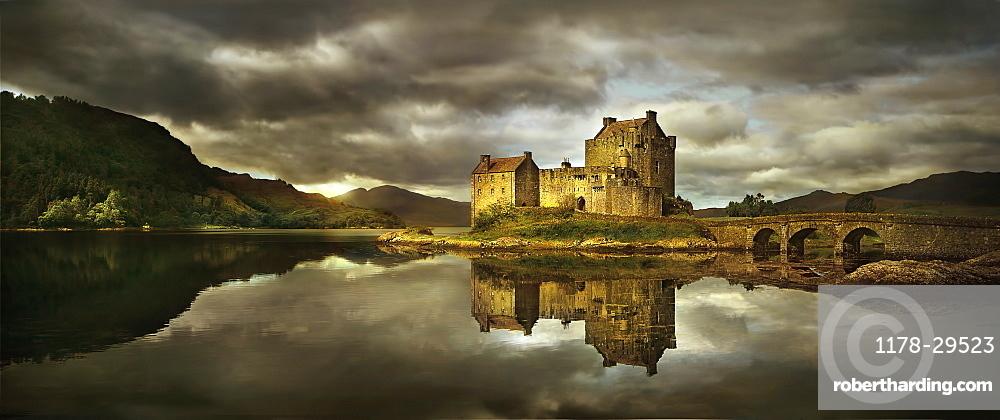 United Kingdom, Scotland, Medieval castle reflecting in lake