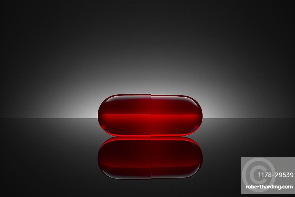 Studio shot of red pill