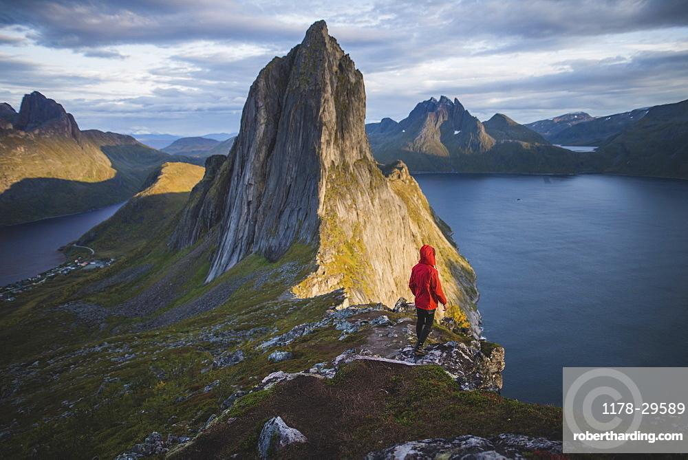 Norway, Senja, Man standing nearSeglamountain