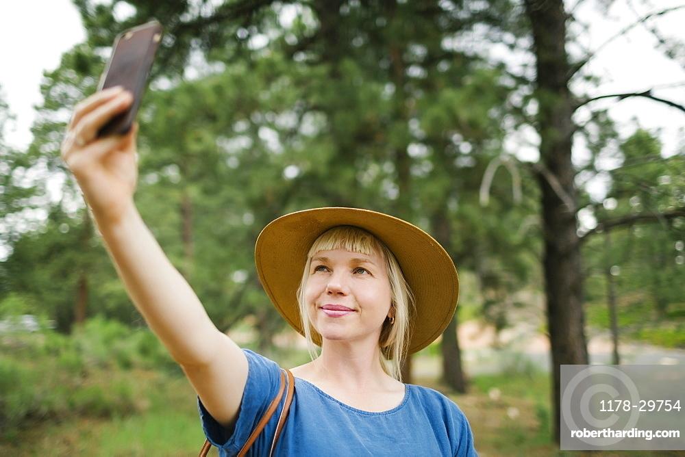 USA, Utah, Bryce Canyon, Woman taking selfie in national park