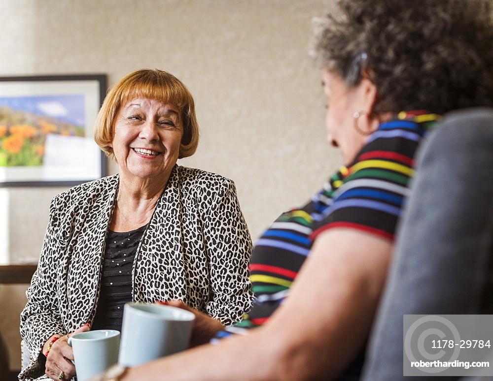 Senior women drinking tea and talking