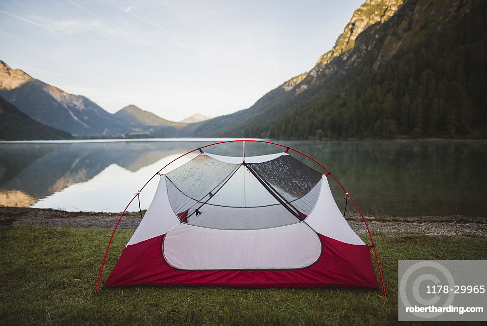 Austria, Plansee, Tent by lake Plansee in Austrian Alps at sunrise