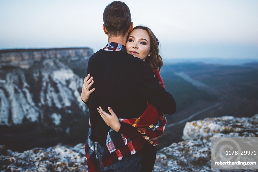 Ukraine, Crimea, Young couple hugging near canyon