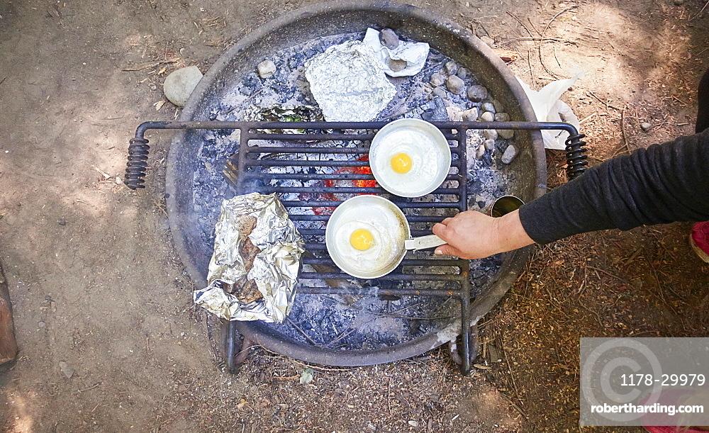 Preparing breakfast at camping