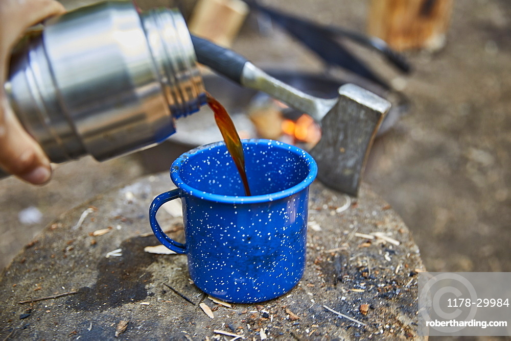 Man pouring coffee at camping