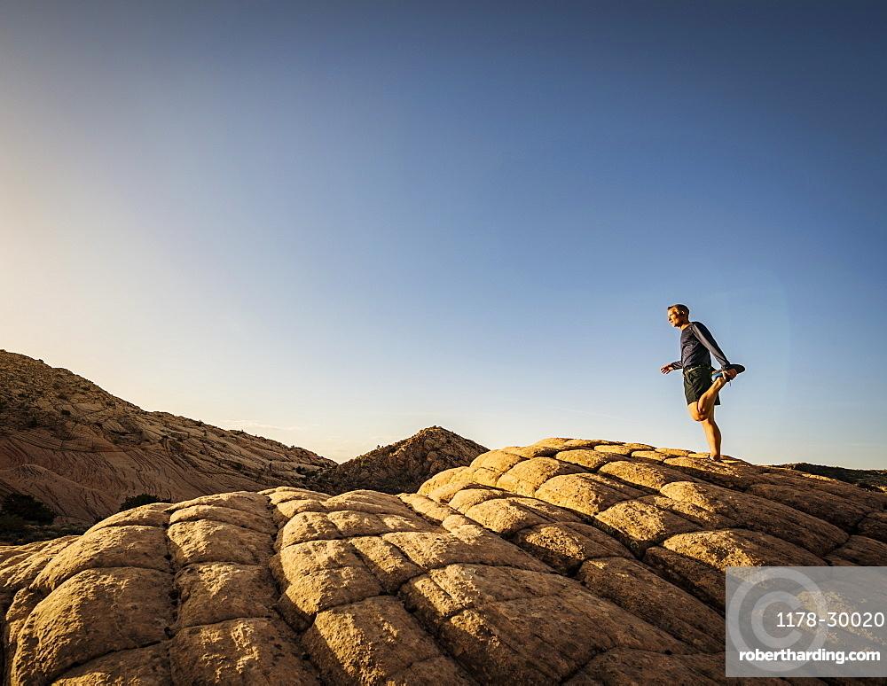 USA, Utah, St. George, Man exercising in rocky landscape