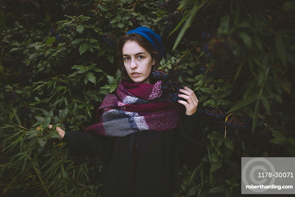 Ukraine, Crimea, Portrait of young woman wearing beret and scarf