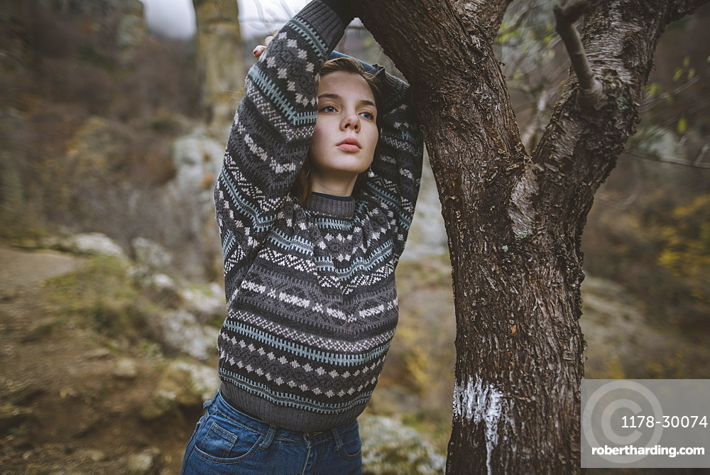 Ukraine, Crimea, Portrait of young woman in sweater