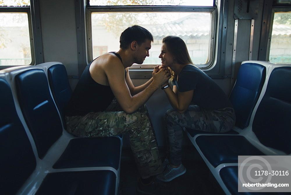 Romantic couple on train