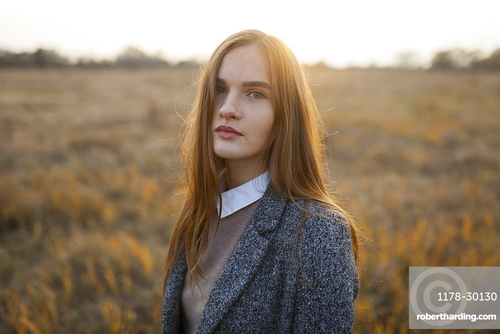 Russia, Omsk, Portrait of young woman in field