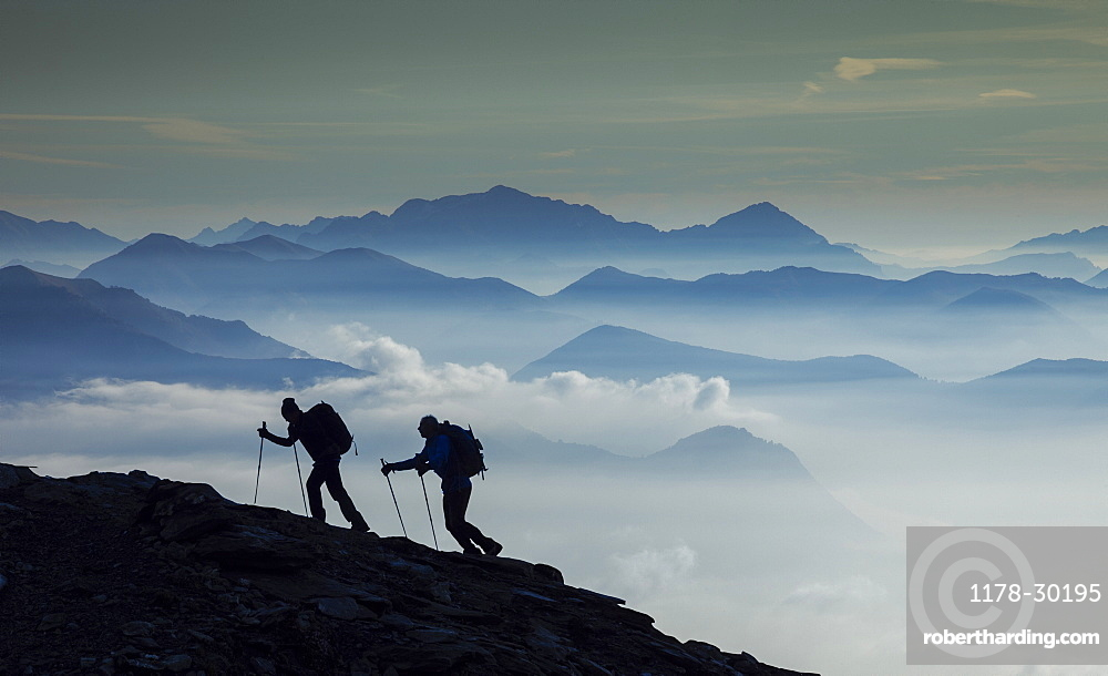 Italy, Piedmont, Alps, Monte Rosa, Silhouette of two climbers on mountain ridge