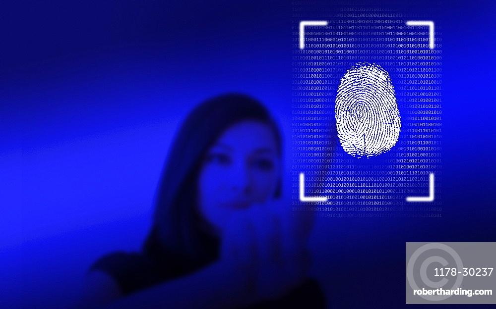 Woman leaving her fingerprint on screen