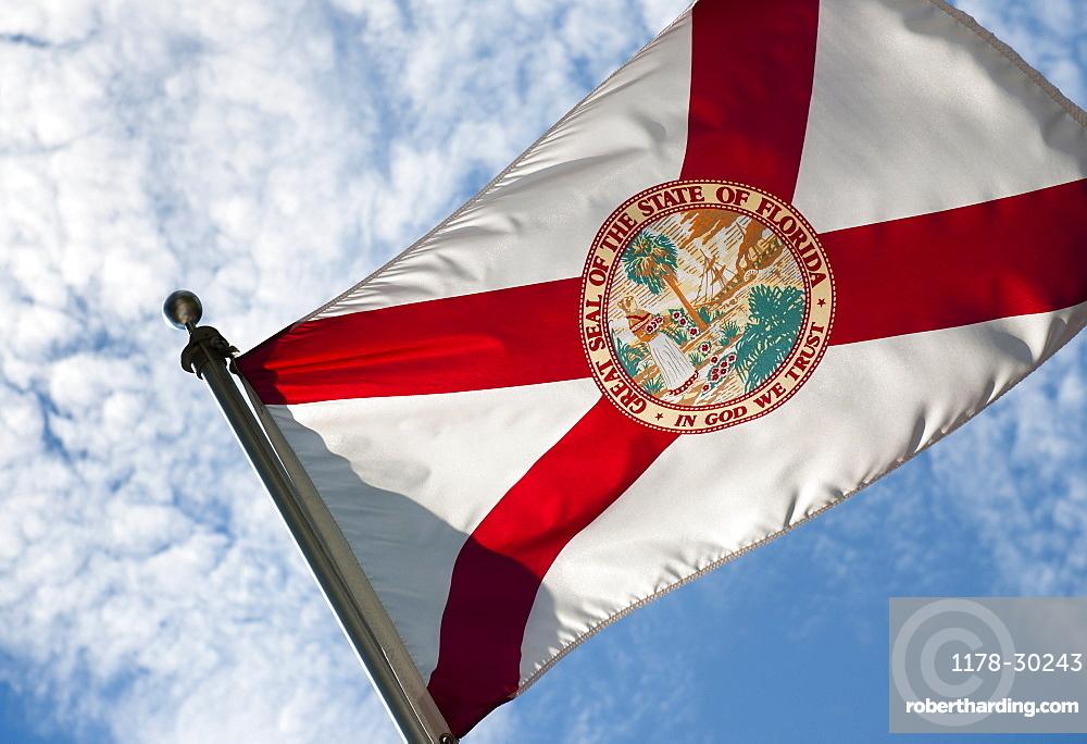 USA, Florida, State flag of Florida against cloudy sky