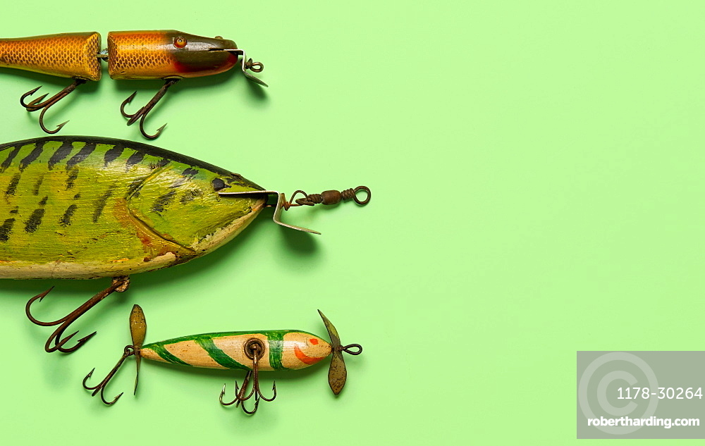 Antique fishing lures on green background