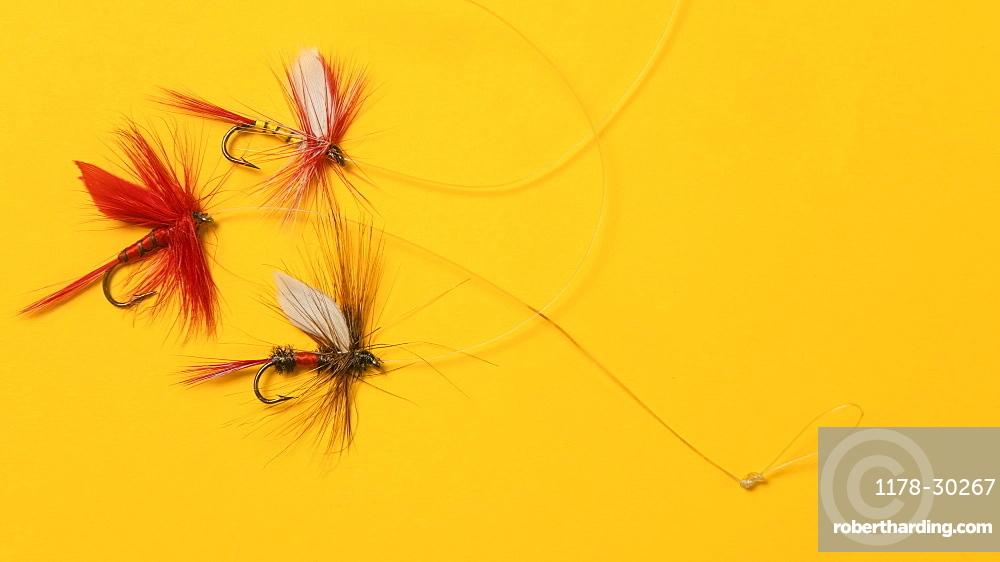Antique fishing lures arranged on orange background