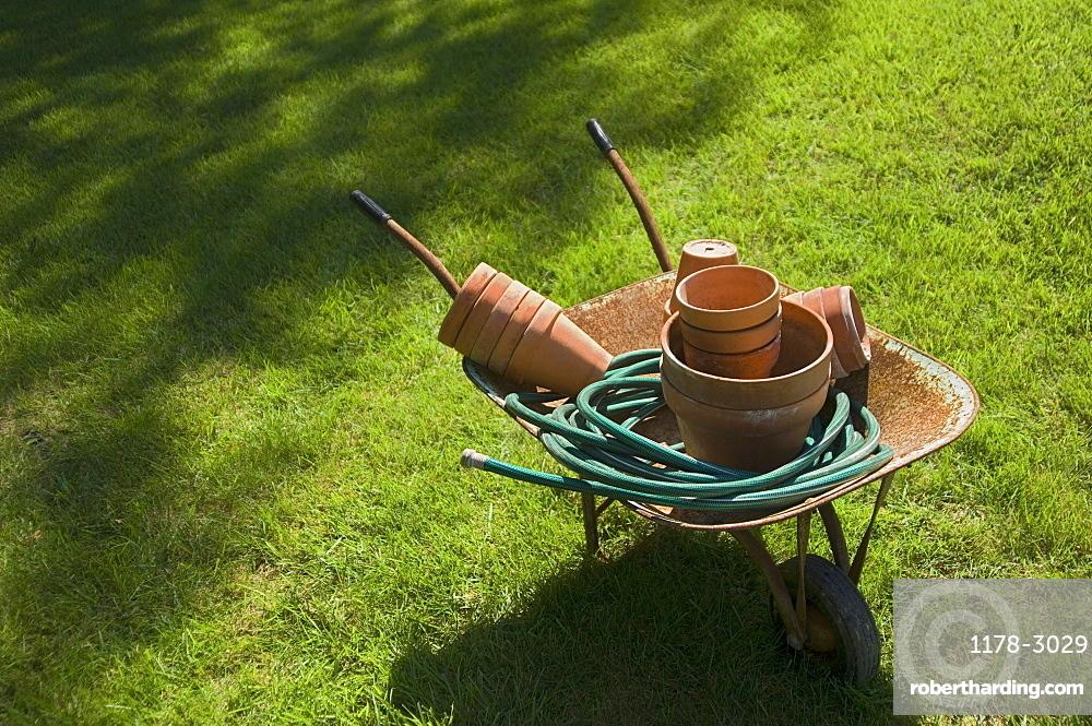Still life of wheelbarrow and gardening tools