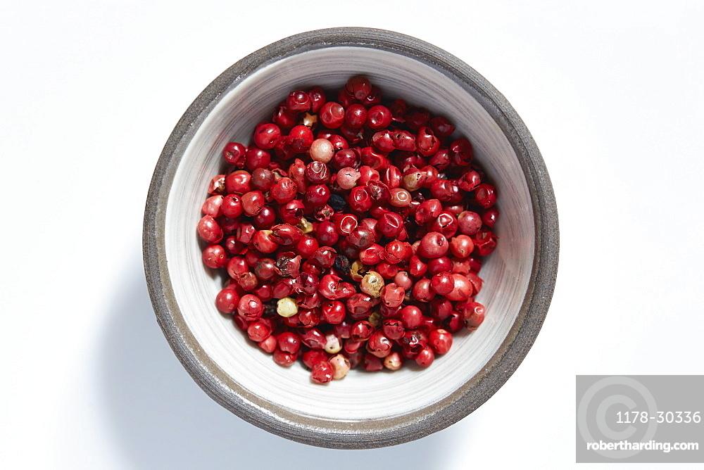 Red peppercorns in bowl