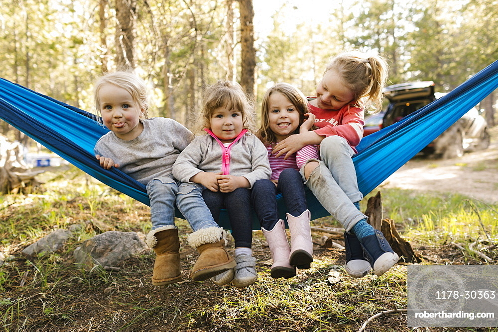 Girls (2-3, 4-5, 6-7) in hammock in Uinta-Wasatch-Cache National Forest