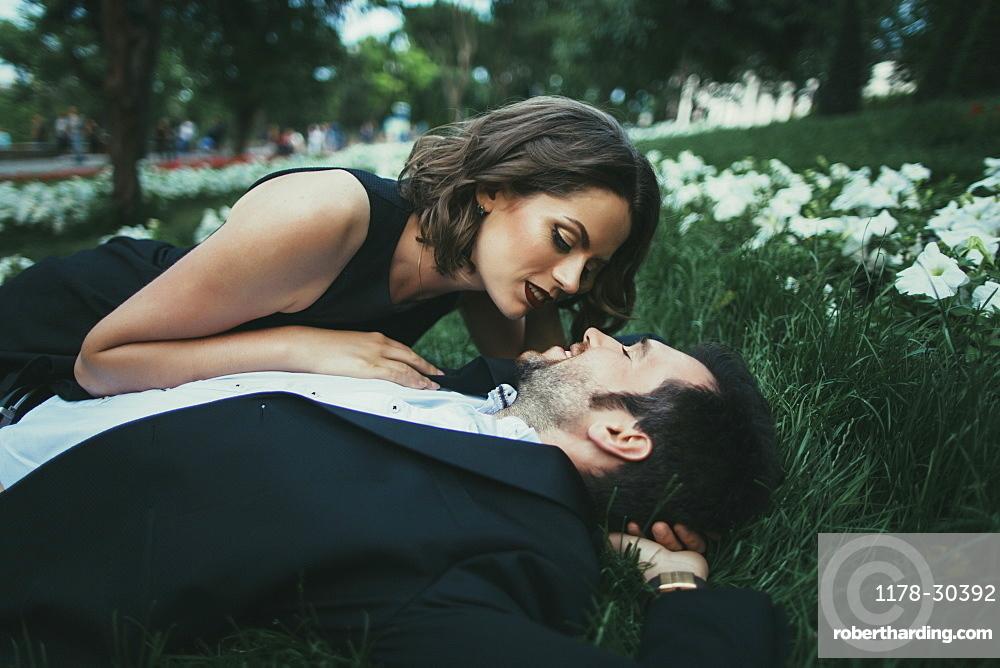 Ukraine, Couple embracing in garden