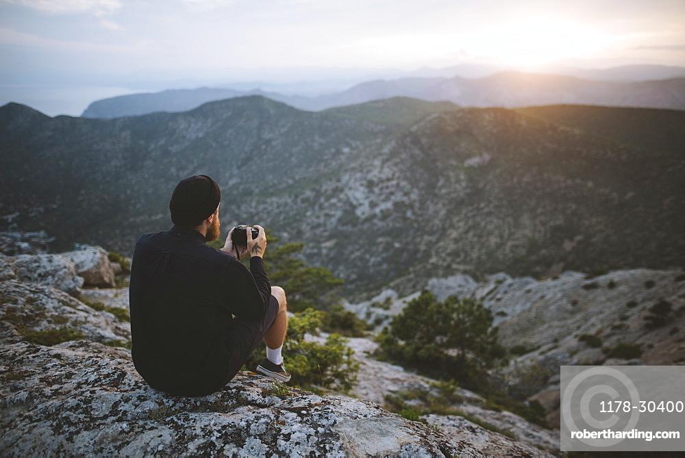 Italy, Liguria, La Spezia, Man looking at mountain range from mountain top