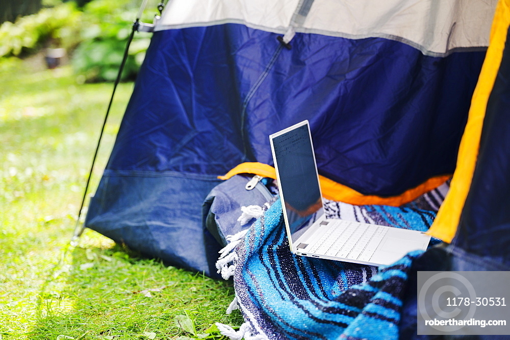 Tent and laptop in garden